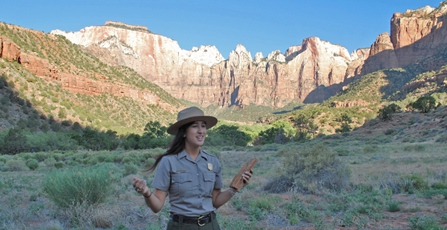 A ranger interprets geology in front of the Towers of the Virgin.