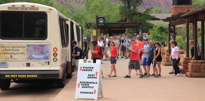 Visitors waiting in line for the shuttle.