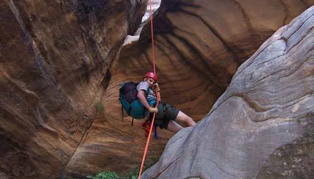 A canyoneerer rappelling